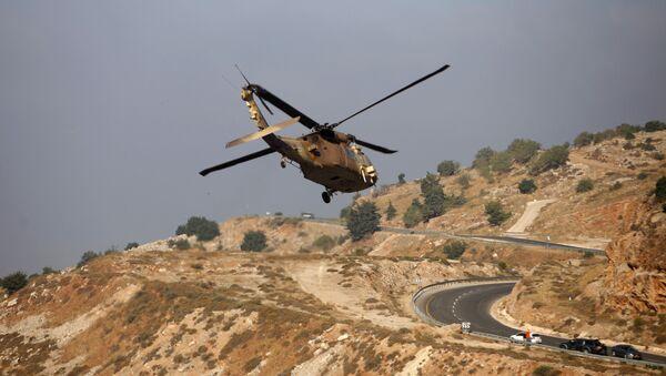 Izraelski helikopter wojskowy w rejonie Wzgórz Golan - Sputnik Polska