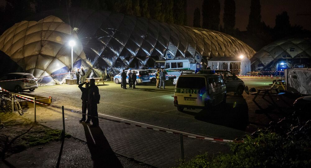 Policja w pobliżu schroniska dla migrantów w berlińskiej dzielnicy Moabit, gdzie policja zastrzeliła 29-letniego imigranta
