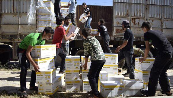 Pomoc humanitarna w Syrii - Sputnik Polska