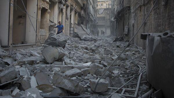 Ruiny po ostrzale Aleppo przez amerykańskie siły powietrzne - Sputnik Polska
