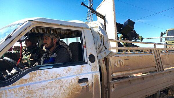 Żołnierze Syryjskiej Armii Arabskiej w wyzwolonym od terrorystów mieście Szejch-Miskin - Sputnik Polska