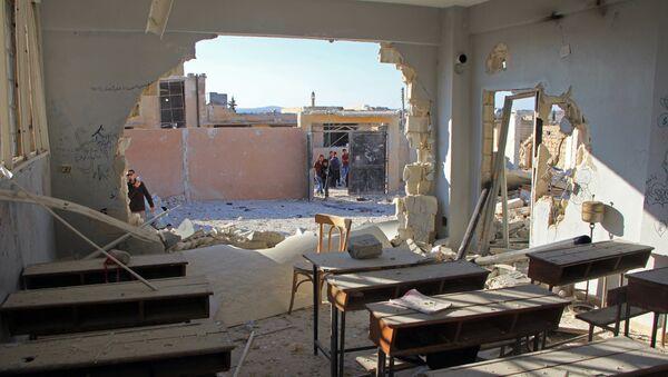 Zbombardowana szkoła w miejscowości Hass w prowincji Idlib, 26 października 2016 - Sputnik Polska