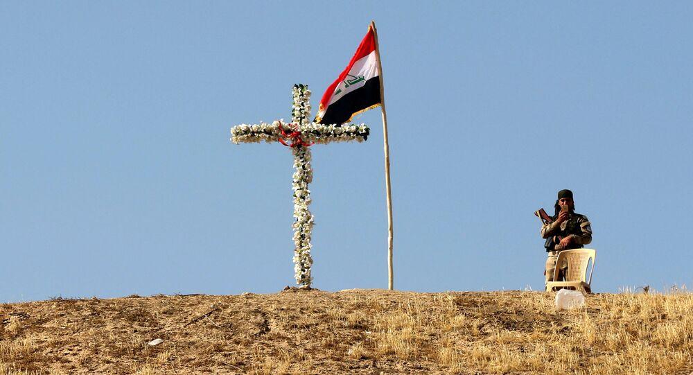 Żołnierz nieopodol kościoła w Mosulu. Irak