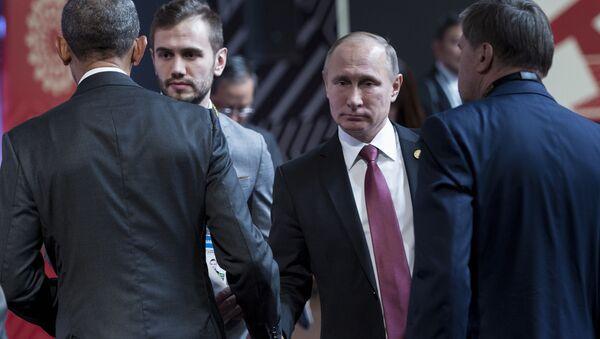 Rozmowa prezydenta USA Baracka Obamy i prezydenta Rosji Władimira Putina podczas szczytu APEC w Peru - Sputnik Polska
