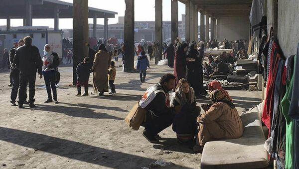 Cywile wyprowadzeni ze wschodniego Aleppo, 12 grudnia 2016 - Sputnik Polska