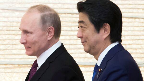 Władimir Putin i Shinzo Abe, 16.12.2016. - Sputnik Polska