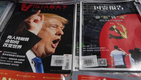 Okładka gazety w Pekinie z napisem: Jak biznesmen Trump zmieni świat?, 12 grudnia 2016 - Sputnik Polska