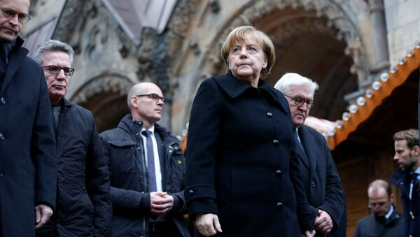 Angela Merkel i Frank Walter Steinmeier w Berlinie, w miejscu zamachu. 20.12.2016. - Sputnik Polska
