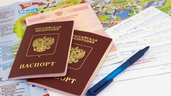 Paszporty i mapa - Sputnik Polska