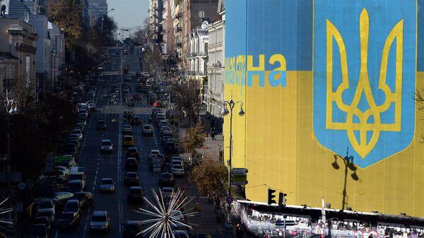 Ukraińska flaga na fasadzie budynku. Kijów - Sputnik Polska