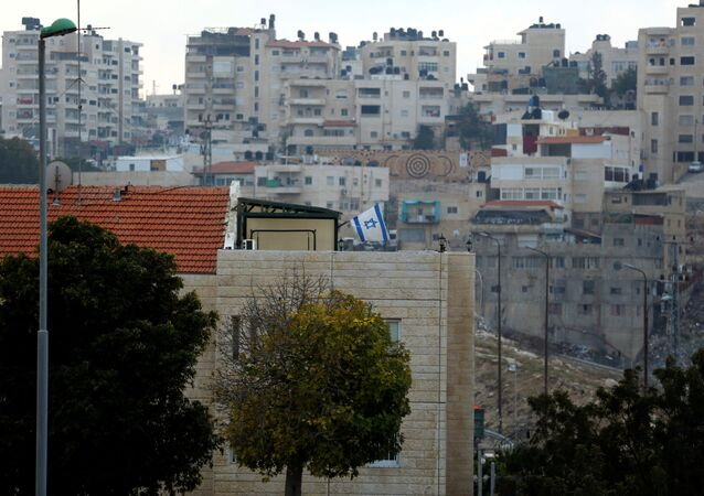 A building can be seen in the Israeli settlement of Maale Edumim, in the occupied West Bank, in the background the Palestinian village of Azariya is seen on the edge of Jerusalem, December 24, 2016