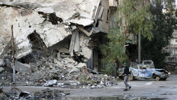 Zniszczenia w syryjskim mieście Dajr az-Zaur - Sputnik Polska