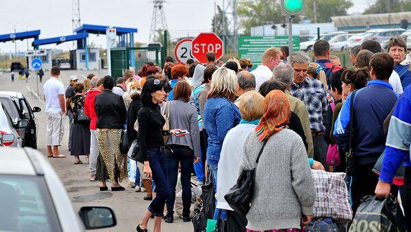 Ukraińscy migranci na granicy z Rosją - Sputnik Polska