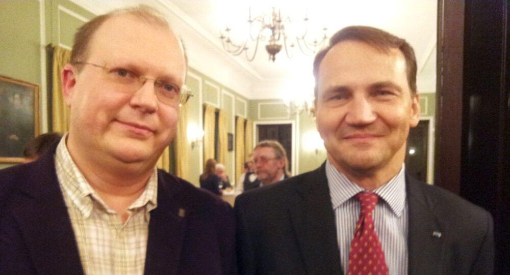 Były minister spraw zagranicznych Radosław Sikorski i dziennikarz Rossiya segodnya Leonid Swiridow