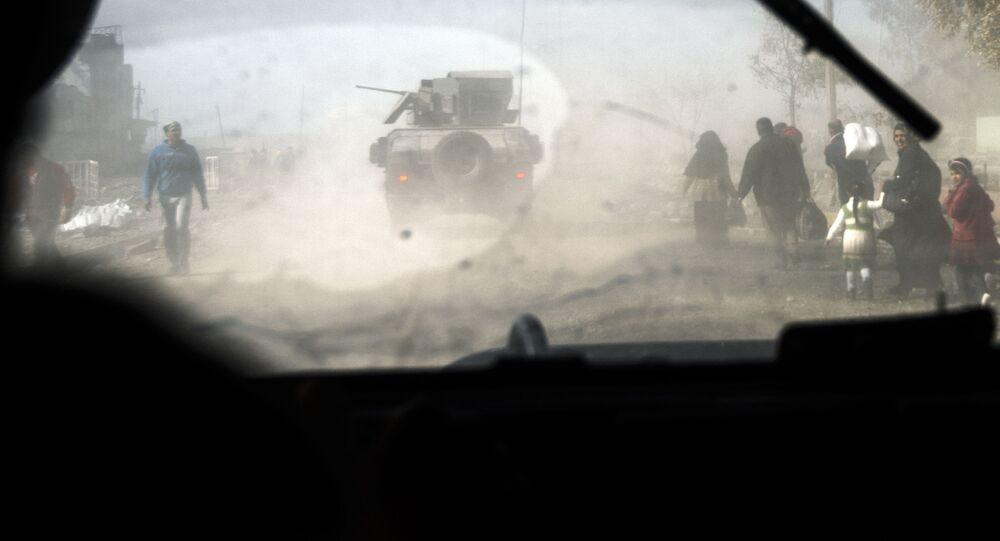 Czołgi i cywile we wschodnim Mosulu