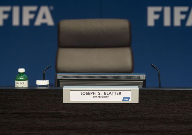Pusty fotel przewodniczącego FIFA Josepha Blattera