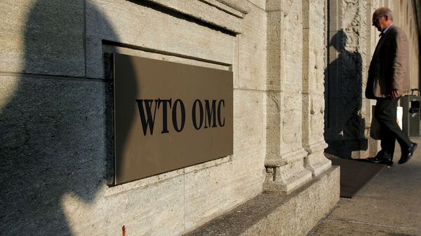 The shadow of a sculpture is reflected on the World Trade Organisation, WTO sign near the entrance of the headquarters, in Geneva (File) - Sputnik Polska