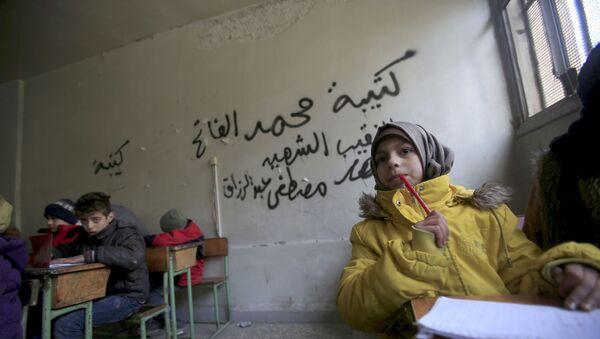 Dzieci na lekcji w Aleppo - Sputnik Polska