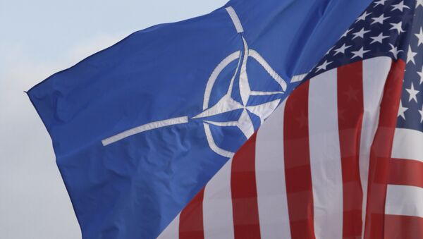 NATO and US flags wave in the wind outside NATO headquarters in Brussels. (File) - Sputnik Polska