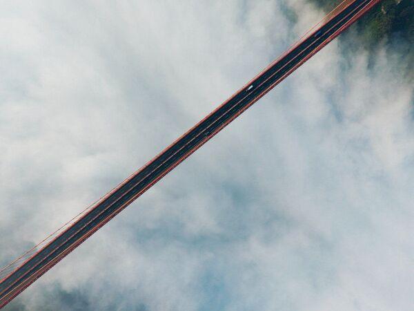 Zdjęcie Nad mostem. Autor: Chenghan. Pierwsze miejsce wśród amatorów w kategorii Piękno. - Sputnik Polska