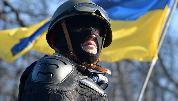 Aktywista antyrządowy na barykadach opozycji w Kijowie - Sputnik Polska