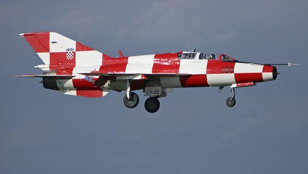 Myśliwiec MiG-21 w barwach chorwackiej flagi. Zdjęcie archiwalne - Sputnik Polska