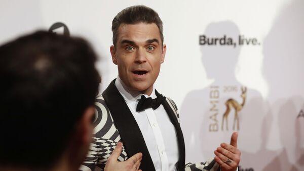 Brytyjski wokalista Robbie Williams - Sputnik Polska