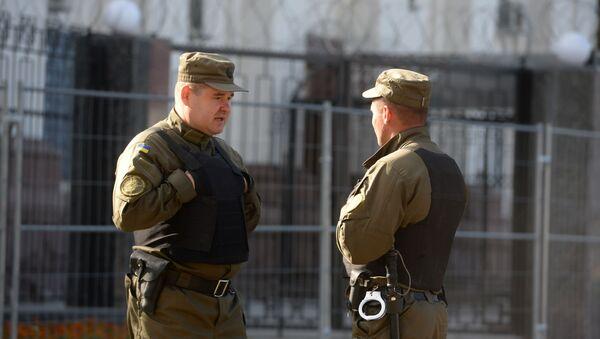 Сотрудники службы безопасности у посольства Российской Федерации в Киеве - Sputnik Polska