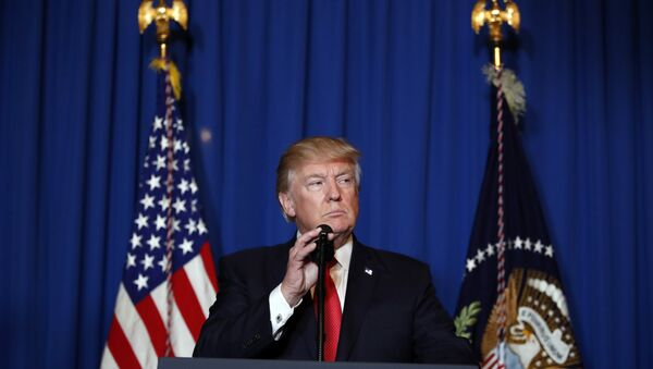 President Donald Trump speaks at Mar-a-Lago in Palm Beach, Fla., Thursday, April 6, 2017, after the U.S. fired a barrage of cruise missiles into Syria Thursday night in retaliation for this week's gruesome chemical weapons attack against civilians. - Sputnik Polska