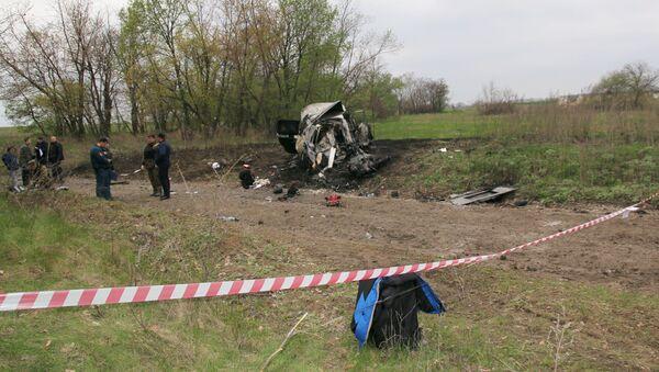 Miejsce, w którym samochód patrolu Specjalnej Misji Monitoringowej OBWE najechał na minę - Sputnik Polska