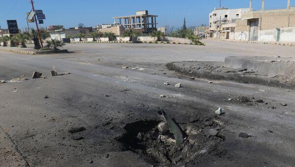 Skutki bombardowania niekontrolowanego przez syryjski rząd miasta Chan Szajchun położonego w prowincji Idlib - Sputnik Polska
