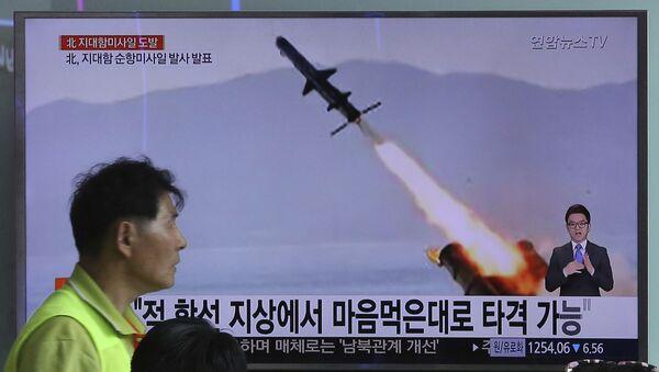 Kadry próby rakietowej w KRLD prezentowane w wiadomościach w Seulu - Sputnik Polska