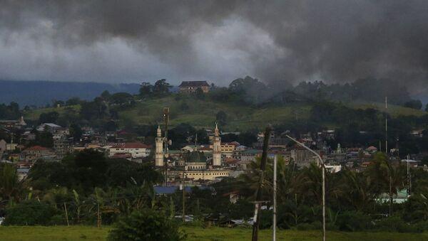 Dym nad filipińskim Marawi - Sputnik Polska