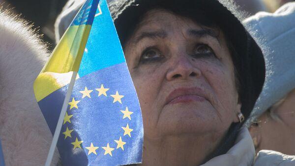 Uczestniczka akcji zwolenników eurointegracji Ukrainy w Kijowie - Sputnik Polska