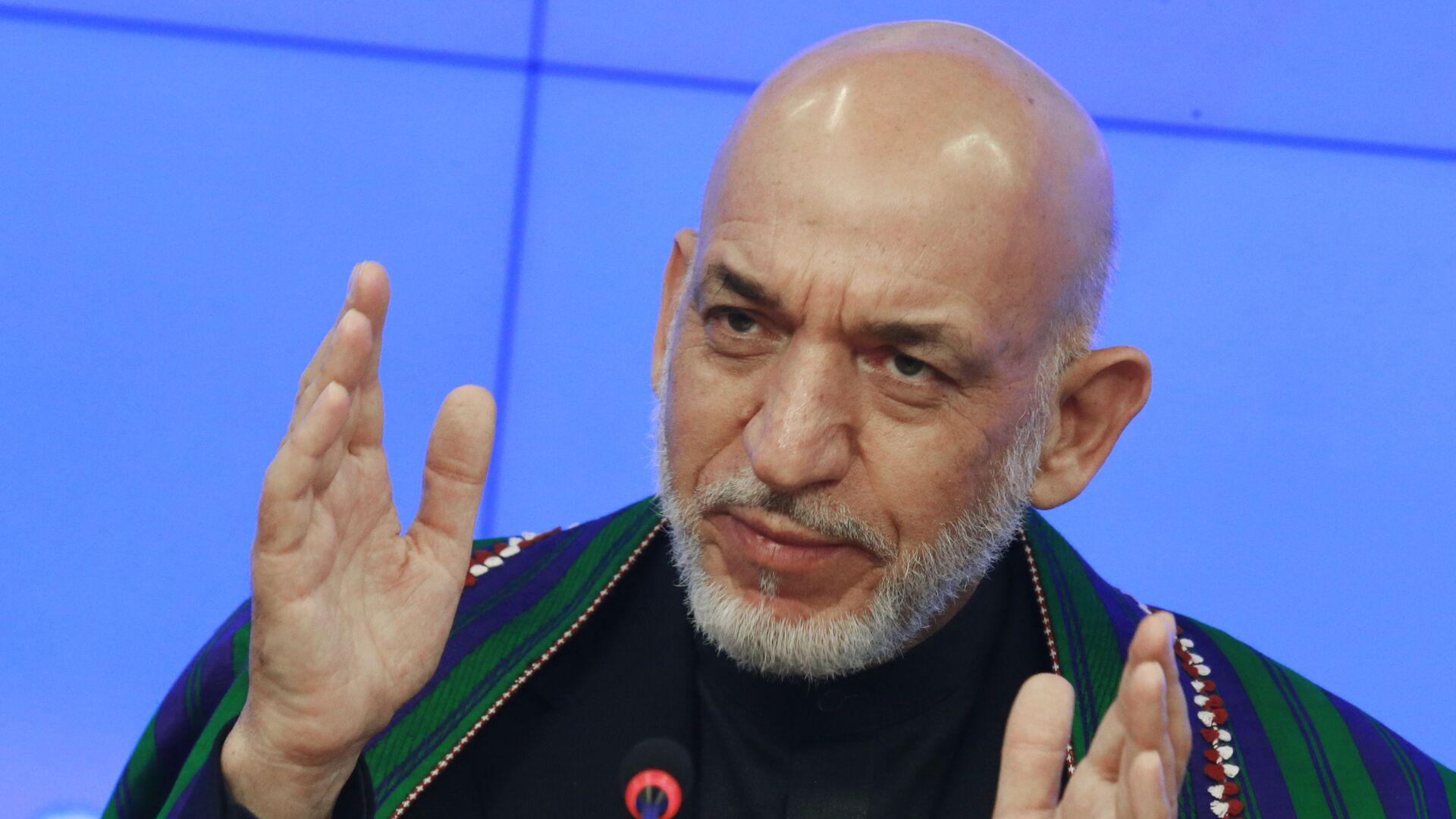 Były prezydent Afganistanu Hamid Karzaj - Sputnik Polska, 1920, 16.08.2021