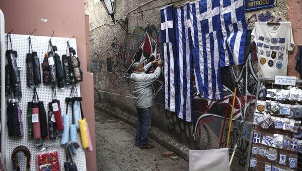Sprzedawca sklepu z pamiątkami w Atenach - Sputnik Polska