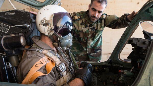 Pilot syryjskich sił powietrznych w bazie Sił Powietrznych Syrii w prowincji Homs - Sputnik Polska