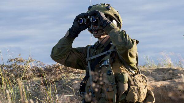 Żołnierz podczas ćwiczeń NATO Saber Strike. Zdjęcia archiwalne - Sputnik Polska