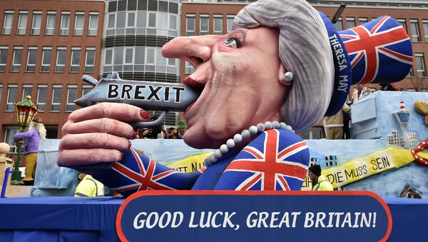 A carnival float depicts British Prime Minister Theresa May with a gun and the writing 'Brexit' on it prior to the traditional carnival parade in Duesseldorf, Germany, on Monday, Feb. 27, 2017. - Sputnik Polska