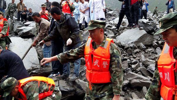 Lawina błotna spowodowała śmierć 141 mieszkańców wsi Xinmo w prefekturze Ngawa, w prowincji Syczuan, w środkowo-zachodniej części Chin - Sputnik Polska