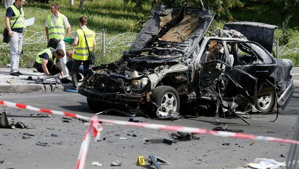 Śledczy na miejscu wybuchu w Kijowie - Sputnik Polska