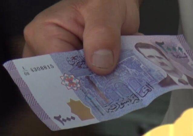 Syryjskie banknoty z wizerunkiem Baszara Asada
