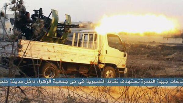 Terroryści islamskiej organizacji terrorystycznej Dżebhat an-Nusra w czasie walki - Sputnik Polska
