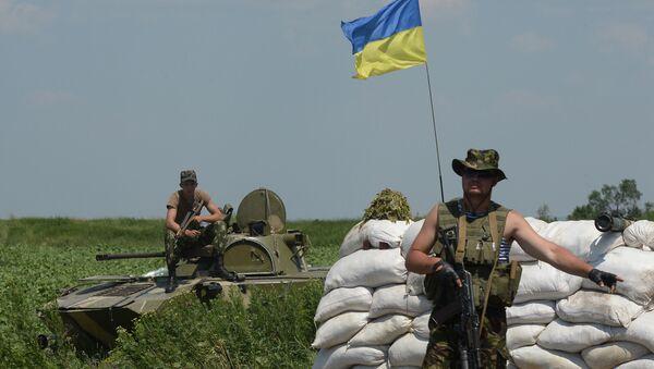 Punkt kontrolny ukraińskich wojskowych w miejscowości Amwrosijewka - Sputnik Polska