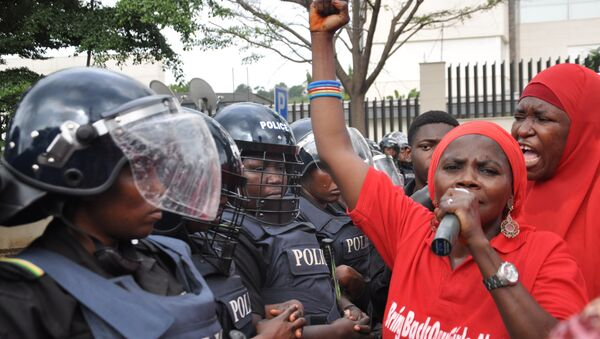Police women in riot gear block the route during a demonstration calling on the government to rescue the kidnapped girls of the government secondary school in Chibok, in Abuja, Nigeria, Tuesday, Oct. 14, 2014. - Sputnik Polska