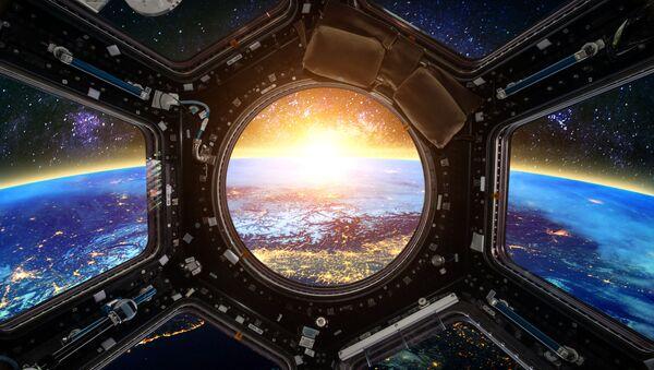 Widok na Ziemię z iluminatora statku kosmicznego - Sputnik Polska