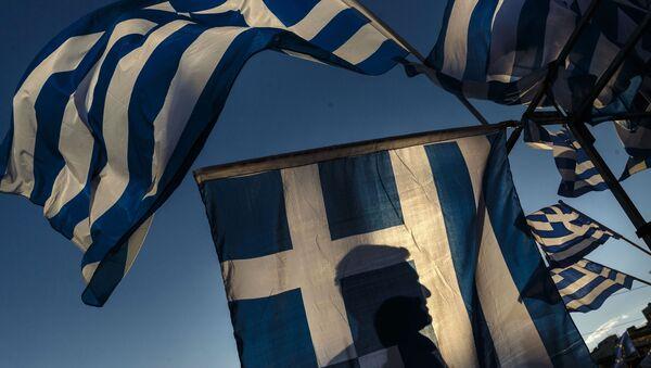 Grecka flaga podczas demonstracji - Sputnik Polska