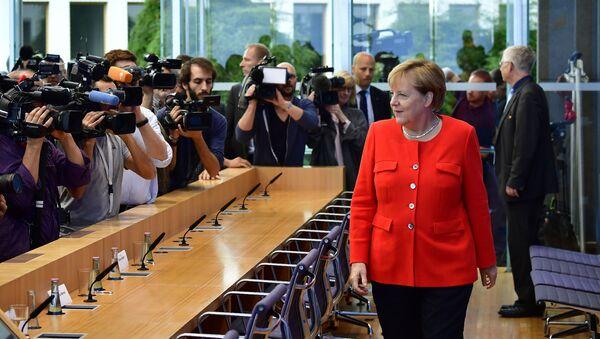 Kanclerz Niemiec Angela Merkal na corocznej konferencji prasowej - Sputnik Polska
