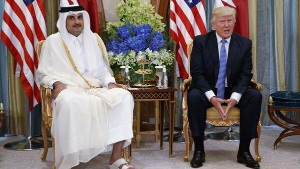 Prezydent USA Donald Trump i emir Kataru Tamim ibn Hamad Al Sani - Sputnik Polska