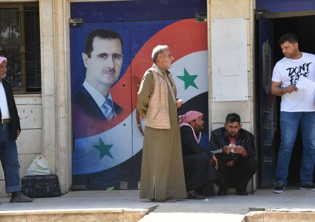 Portret Asada w Syrii